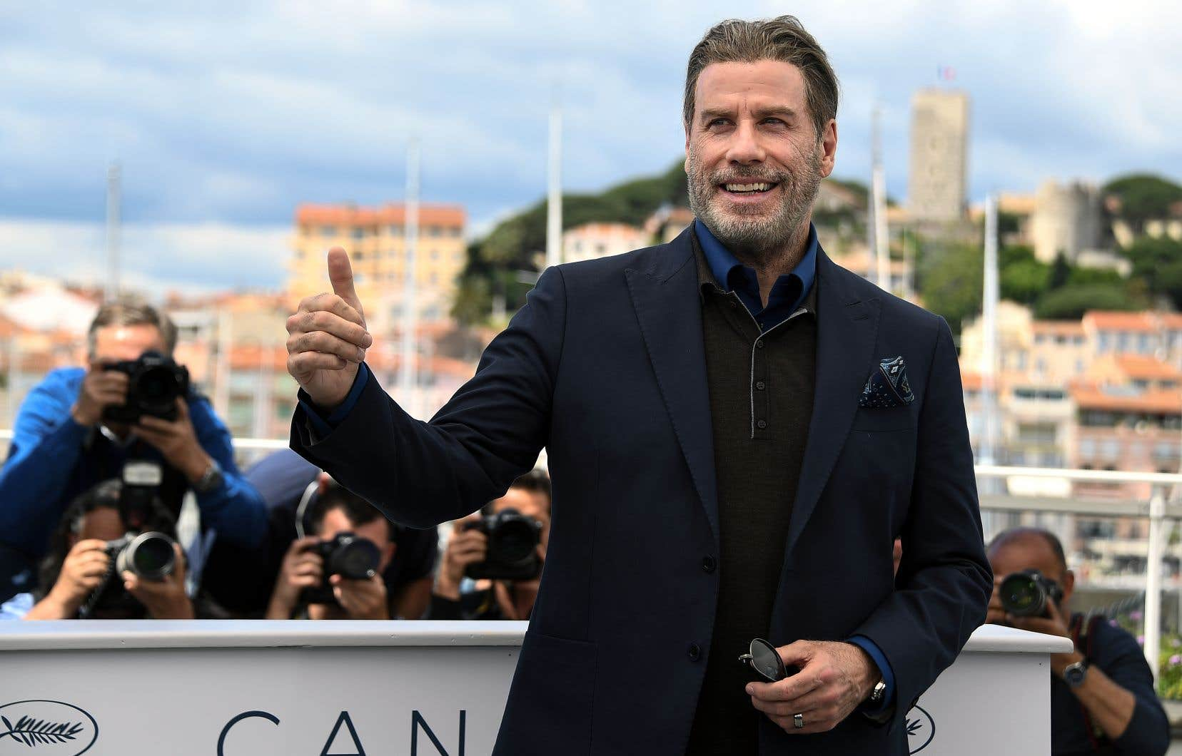 John Travolta était d'une simplicité naturelle sur la Croisette, mercredi.