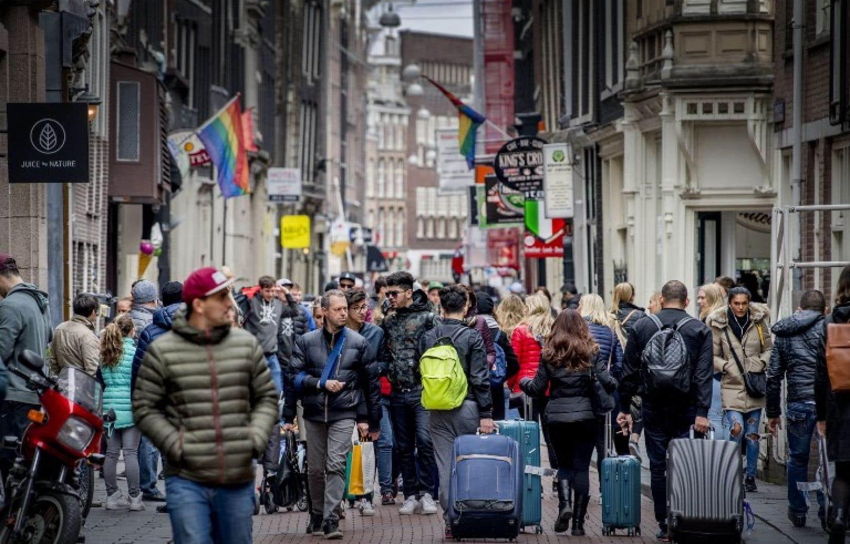 Quelque 18millions de personnes visitent chaque année Amsterdam.