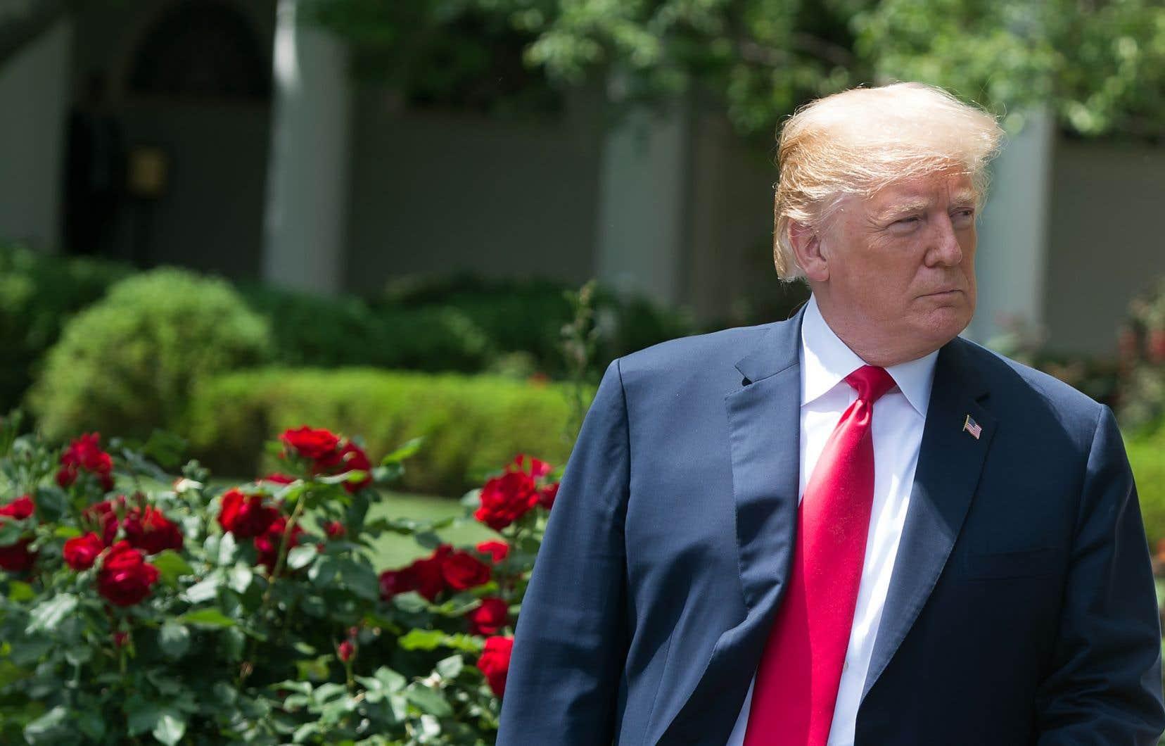 Le président américain dans la roseraie de la Maison-Blanche, à Washington, dimanche
