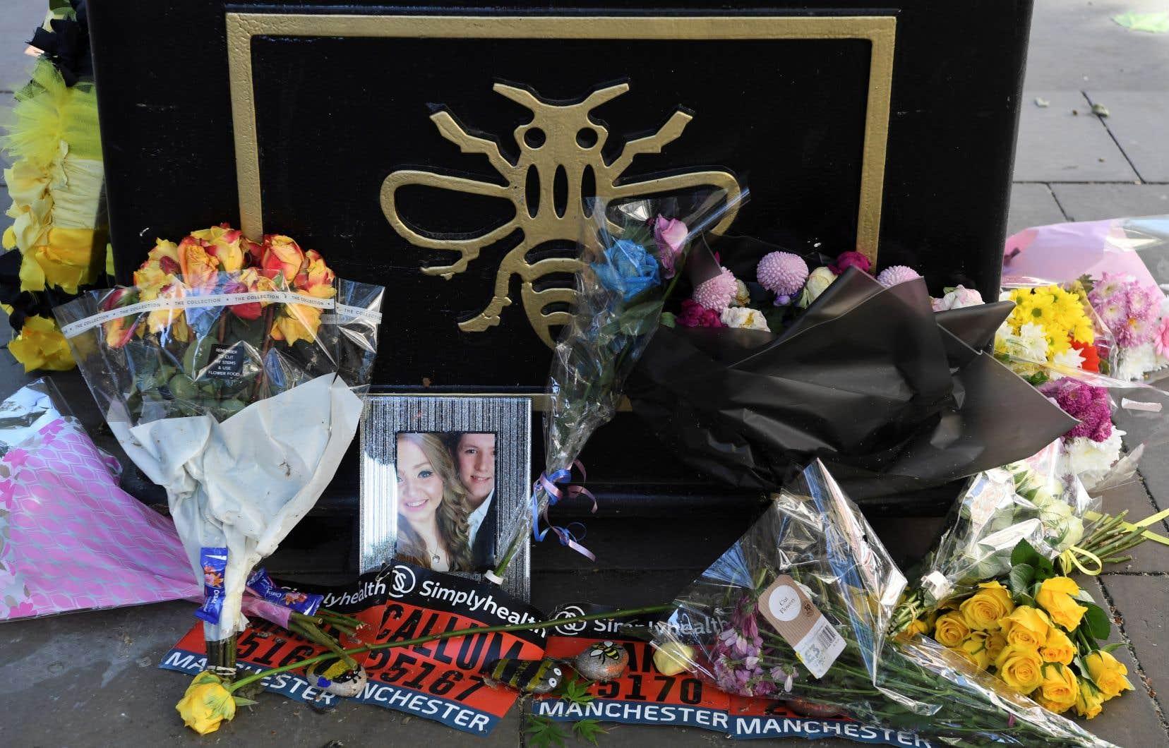 Le Royaume-Uni rend hommage mardi aux victimes de l'attentat suicide de Manchester, qui a tué 22 personnes, il y a un an.