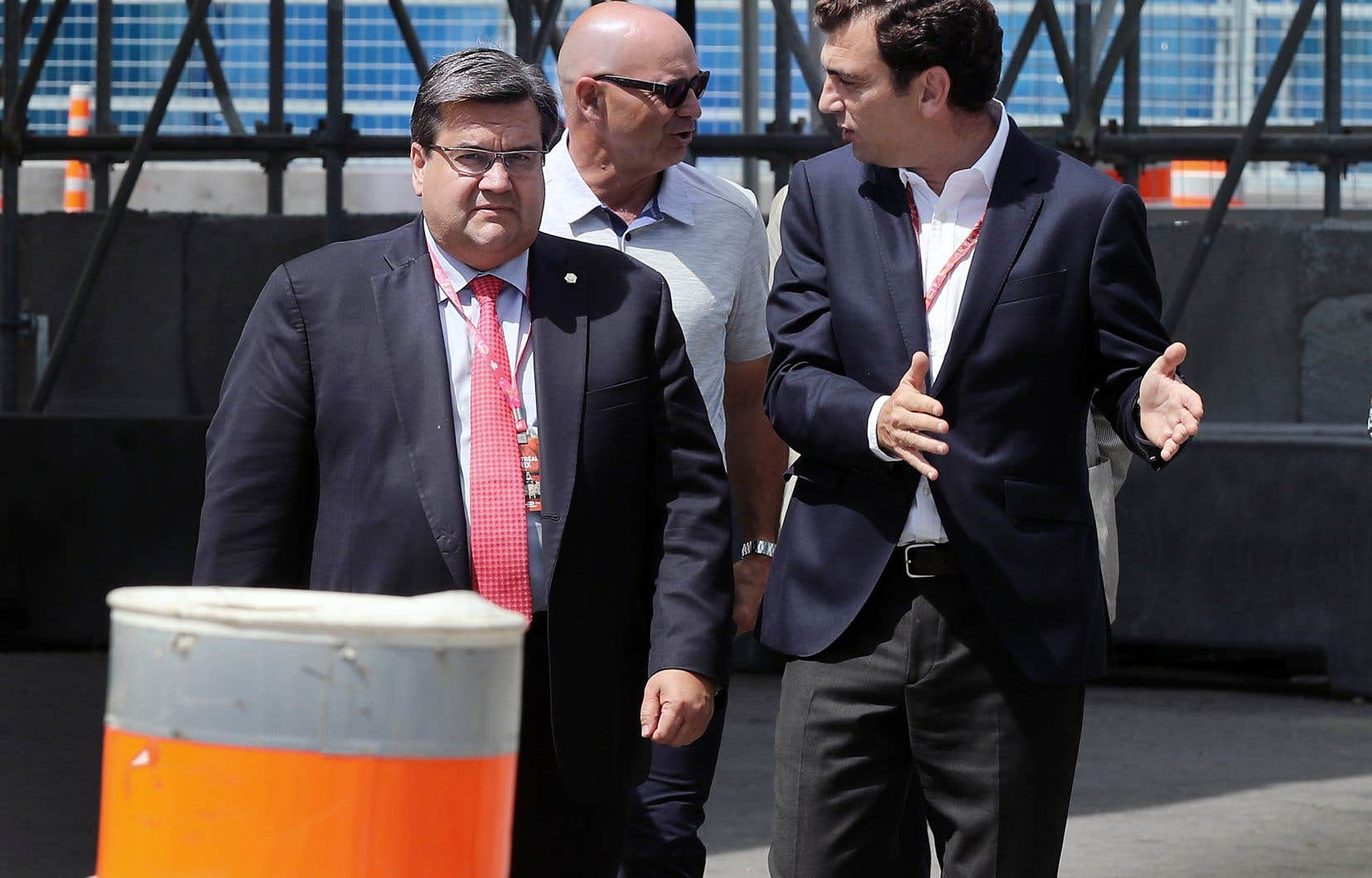 L'ex-maire Denis Coderre en compagnie du promoteur de la Formule E, Alejandro Agag (à droite), en juillet dernier