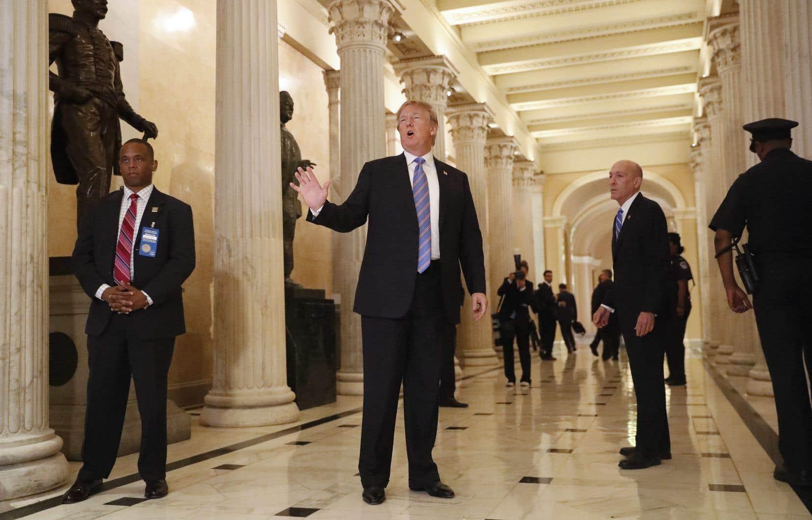 Le président américain, Donald Trump, s'est adressé aux médias avant une rencontre avec sa majorité républicaine au Congrès mardi.