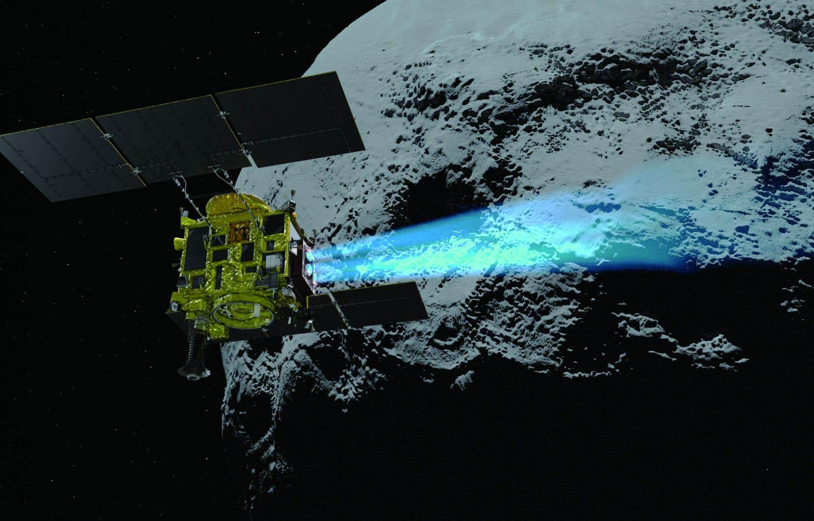 Vue d'artiste de la sonde <em>Hayabusa2</em> et de l'astéroïde Ryugu