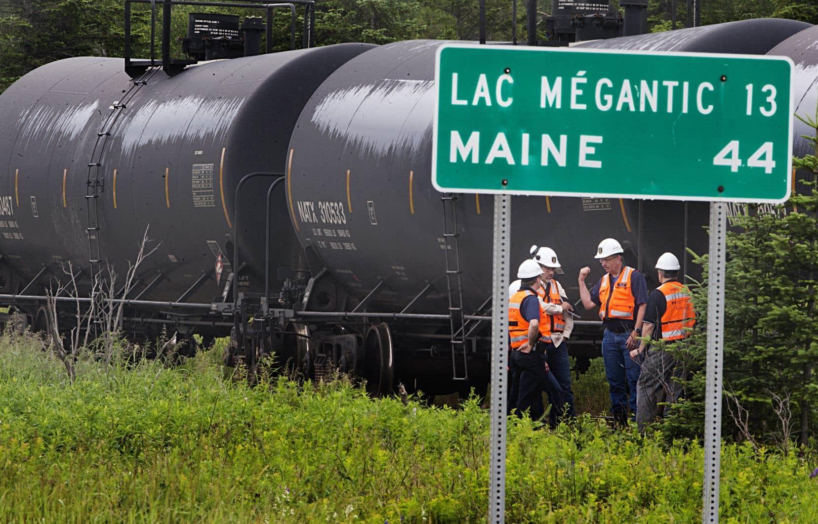 La vérification des systèmes de gestion de la sécurité des compagnies ferroviaires par le ministère des Transports est en cours, mais prend du temps.