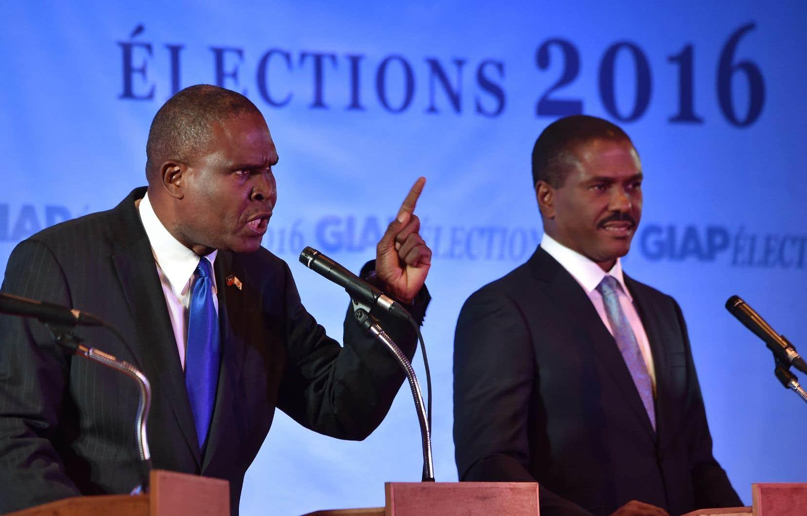 Jean Henry Céant (à gauche) avait obtenu 0,75% des suffrages à l'élection présidentielle de 2016.