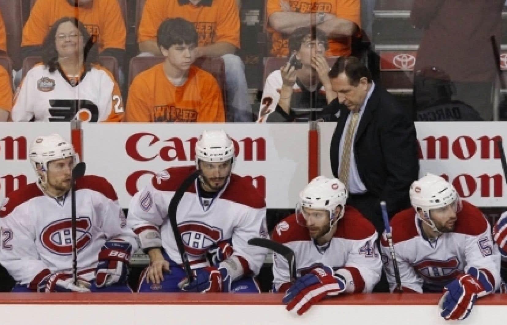 Les joueurs du Canadien et leur entraîneur, Jacques Martin, affichaient des mines déconfites à la fin du match qui a signifié l'élimination de l'équipe, hier, à Philadelphie.