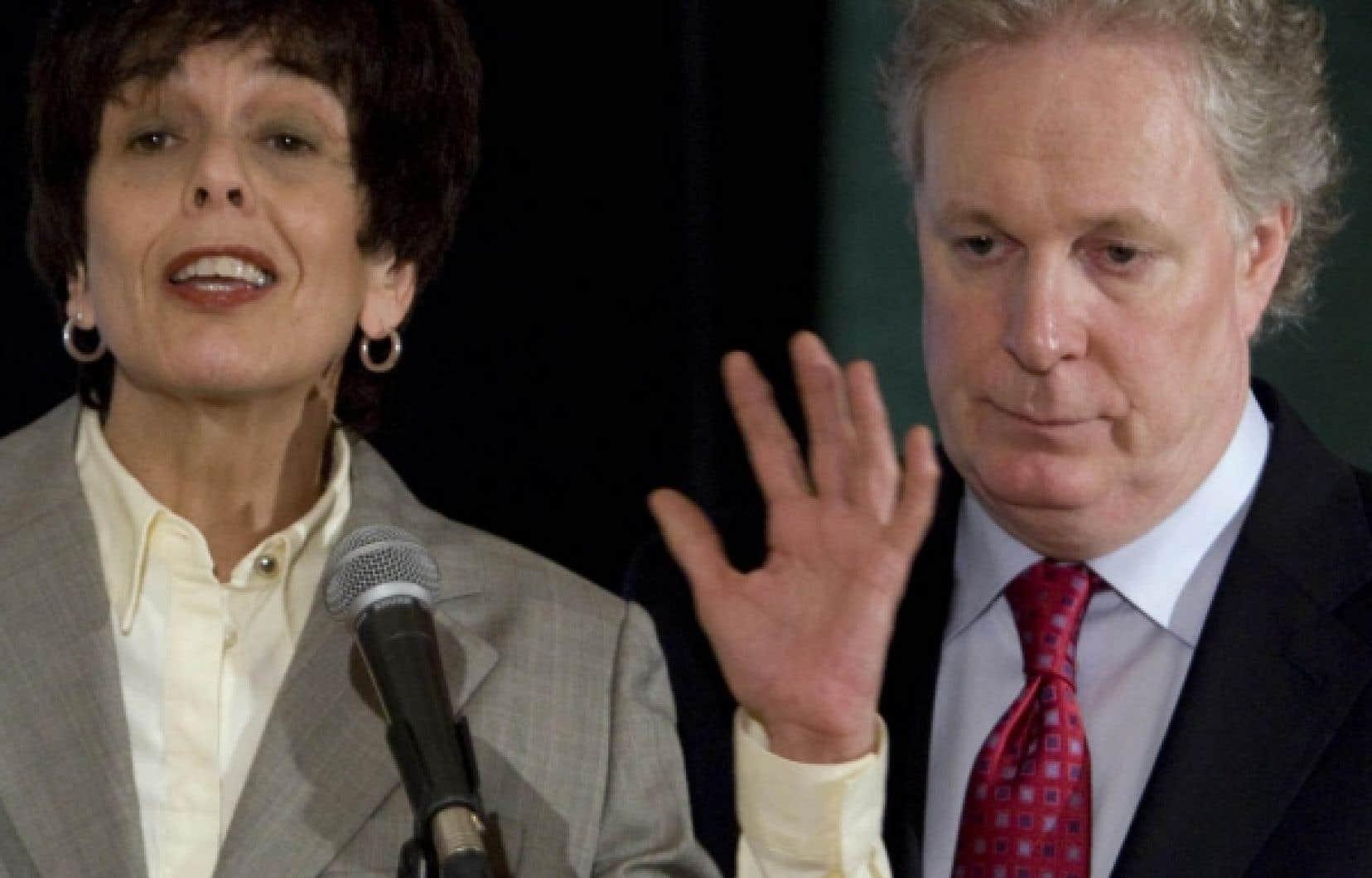 Michelle Courchesne et le premier ministre Jean Charest, en avril dernier: les jours de la ministre de l'Éducation seraient comptés.