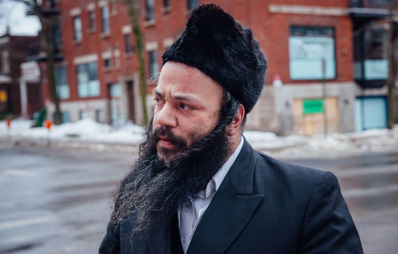 Le porte-parole de la communauté juive hassidique d'Outremont, Abraham Ekstein, juge inacceptable le règlement interdisant l'aménagement de nouveaux lieux de culte sur les artères commerciales.