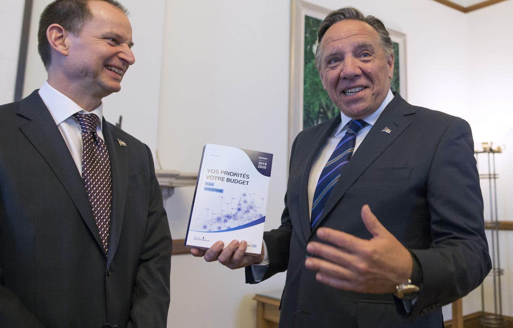 Le ministre québécois des Finances, Eric Girard, et le premier ministre François Legault