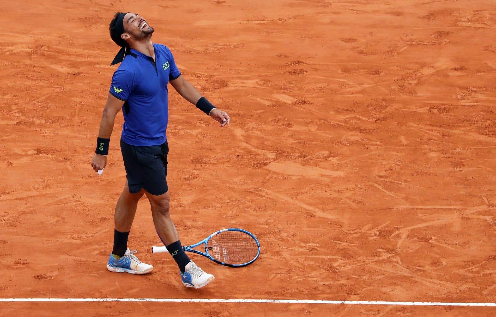 L'Italien Fabio Fognini célèbre sa victoire contre l'Espagnol Rafael Nadal lors de la demi-finale du tennis du tournoi Monte-Carlo ATP Masters Series à Monaco, le 20 avril 2019.