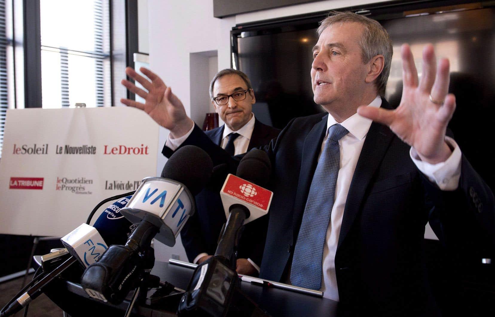 Le président-directeur général du Groupe Capitales Médias, Claude Gagnon (à droite), et le propriétaire de l'entreprise, Martin Cauchon, ont fait l'acquisition en 2015 des quotidiens régionaux du groupe Gesca.