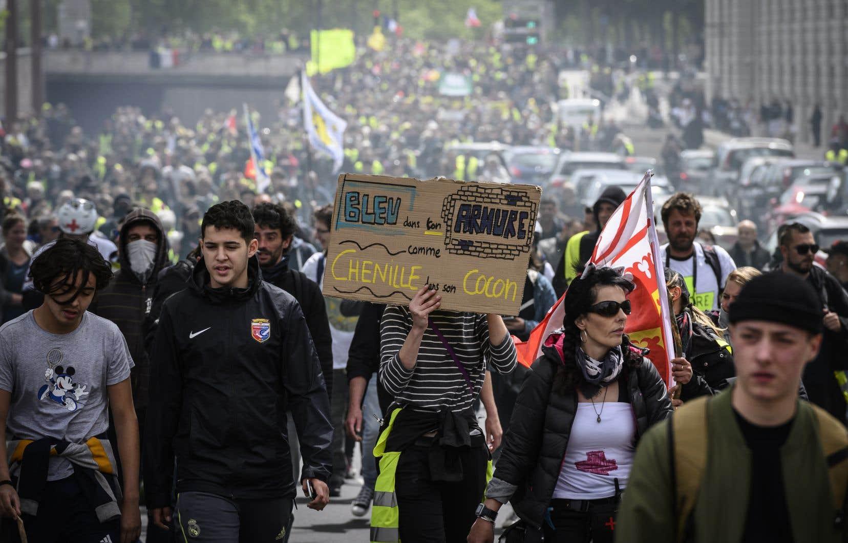 Des manifestants ont défilé à Lyon, dans le centre-est de la France, le 11 mai 2019.
