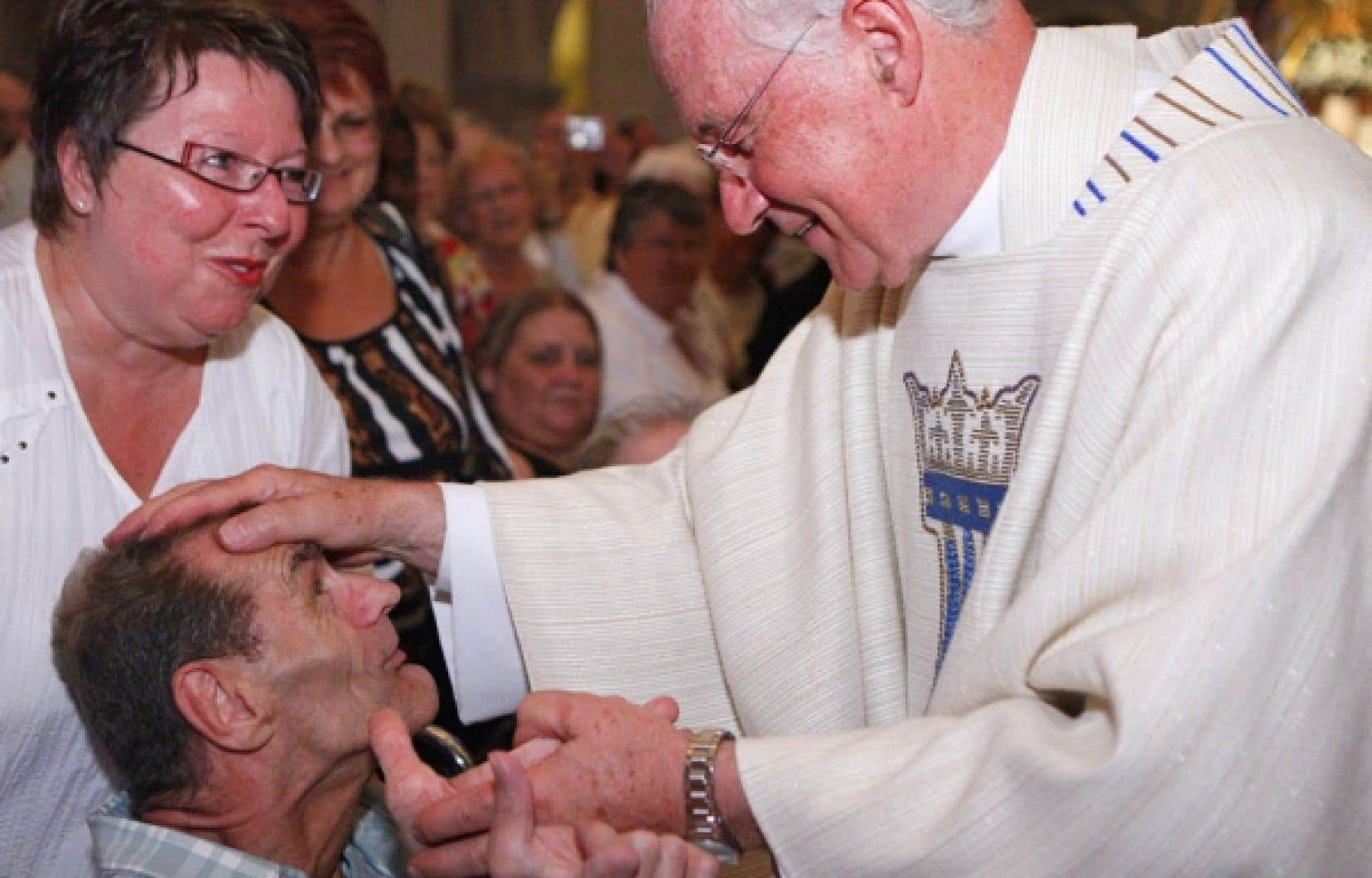 L'archevêque de Québec, Marc Ouellet, a fait ses adieux aux fidèles lors d'une grande messe célébrée hier à la basilique de Sainte-Anne-de-Beaupré.<br />