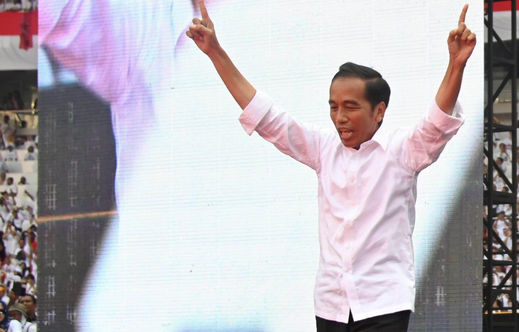 Joko Widodo, 57ans, est vu comme un musulman modéré dans un pays où l'islam conservateur progresse.