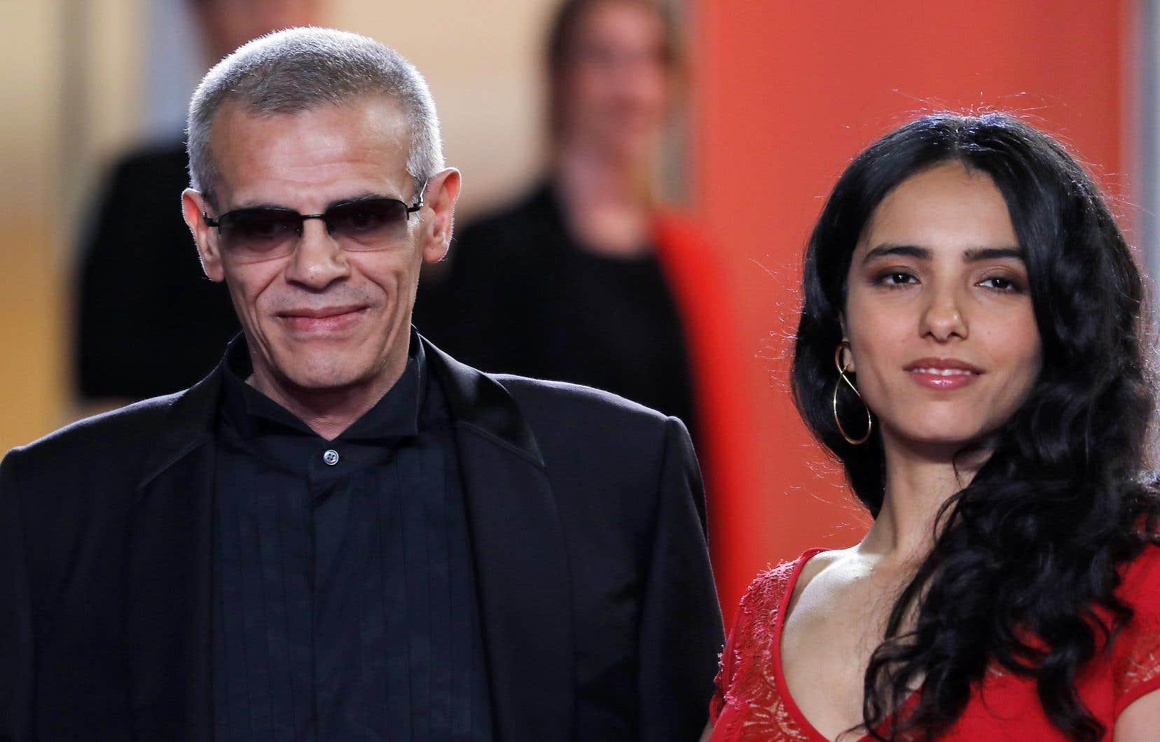 Le cinéaste Abdellatif Kechiche et l'actrice Hafsia Herzi à leur arrivée pour la projection du film Mektoub, «My Love: Intermezzo».