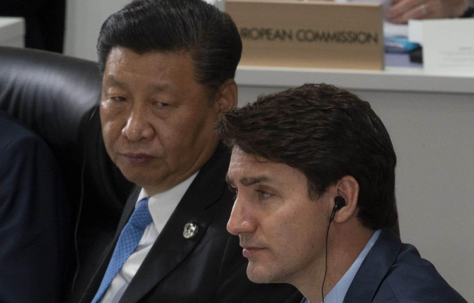Le président chinois Xi Jinping et le premier ministre canadien Justin Trudeau, lors du sommet du G20 à Osaka