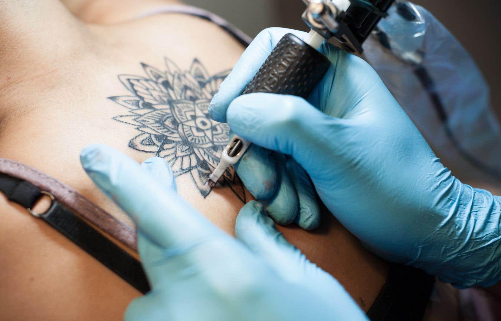 Comment Expliquer La Popularite Exponentielle Du Tatouage Le Devoir