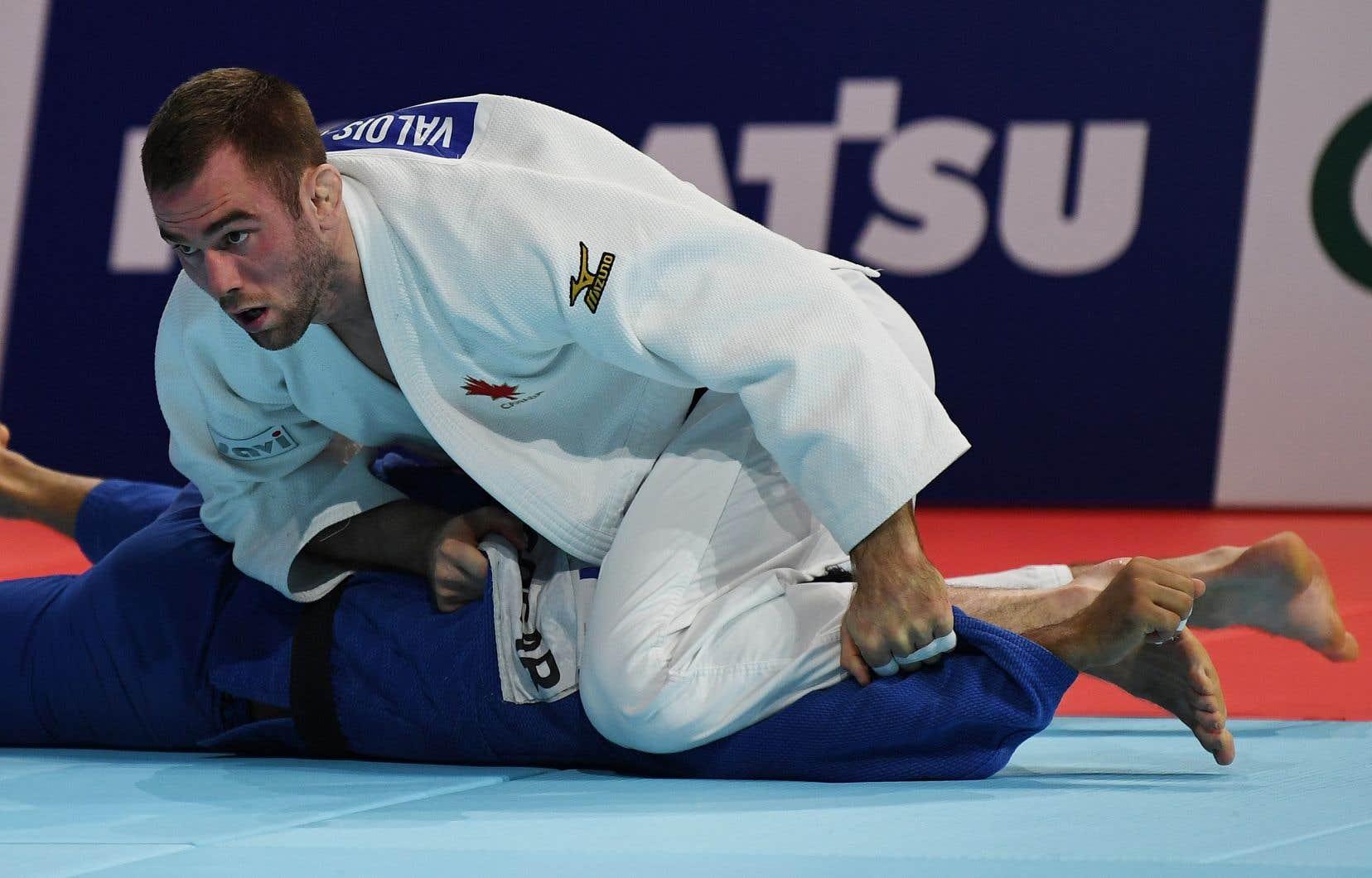 Antoine Valois-Fortier a dû disputer un total de sept combats avant de pouvoir savourer son troisième podium en carrière aux Mondiaux.