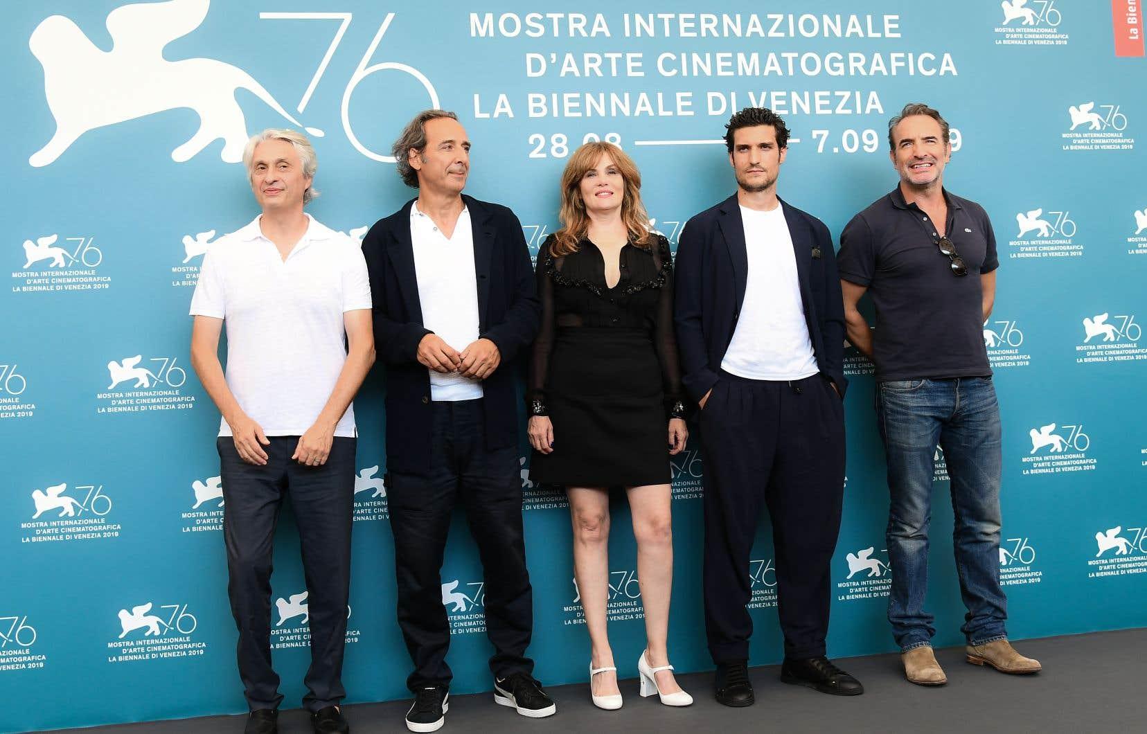 Le producteur Alain Goldman, le compositeur Alexandre Desplat, les acteurs Emmanuelle Seigner, Louis Garrel et Jean Dujardin assistent à une séance photo pour le film «J'accuse» lors du 76ème festival du film de Venise.