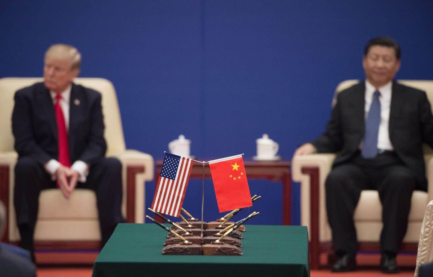 Le conflit commercial entre Pékin et Washington, débuté l'an dernier, menace à présent la croissance des deux premières économies mondiales.