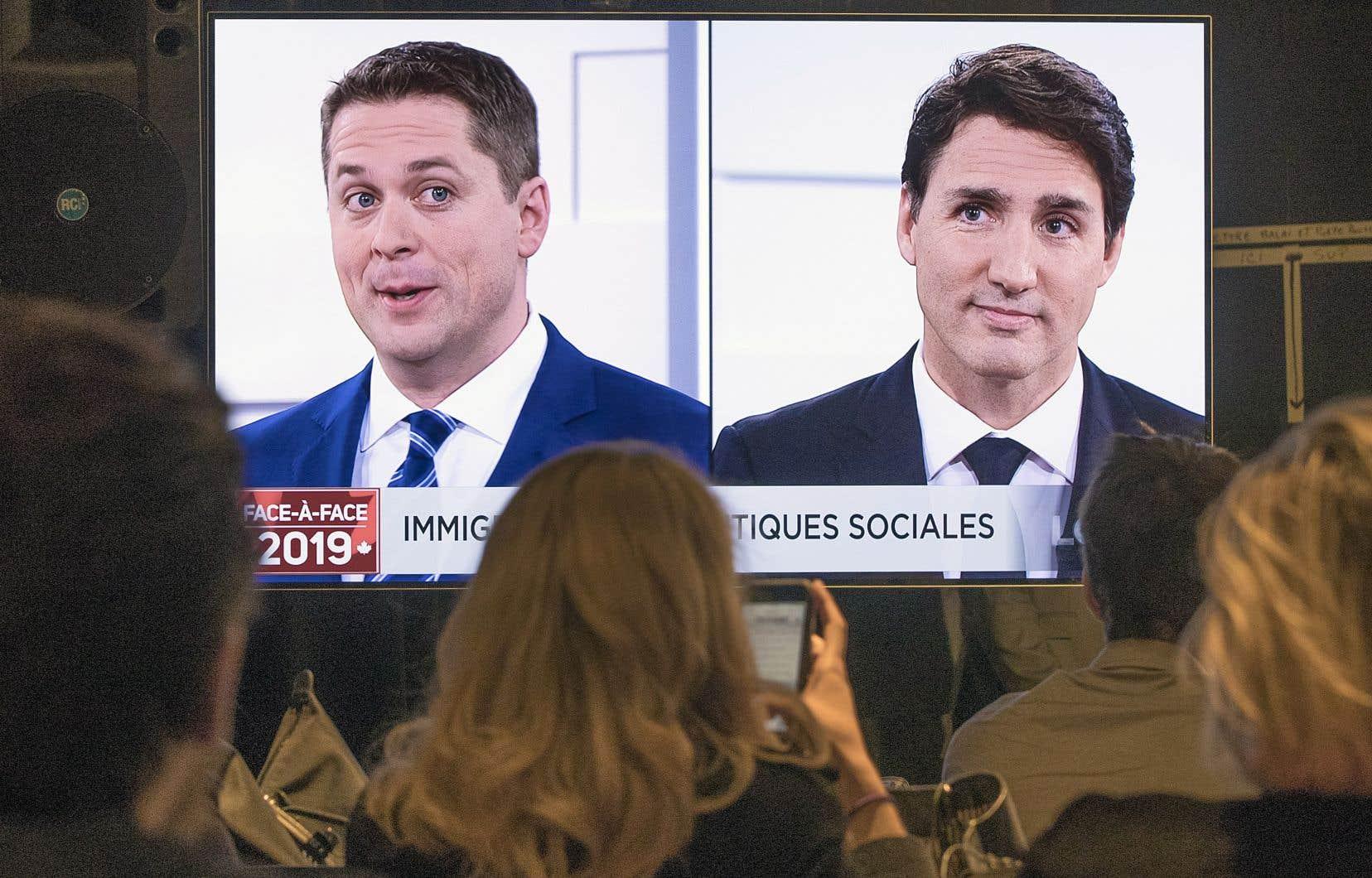 Le chef conservateur, Andrew Scheer (à gauche), a dû essuyer plus d'attaques que le premier ministre libéral, Justin Trudeau.