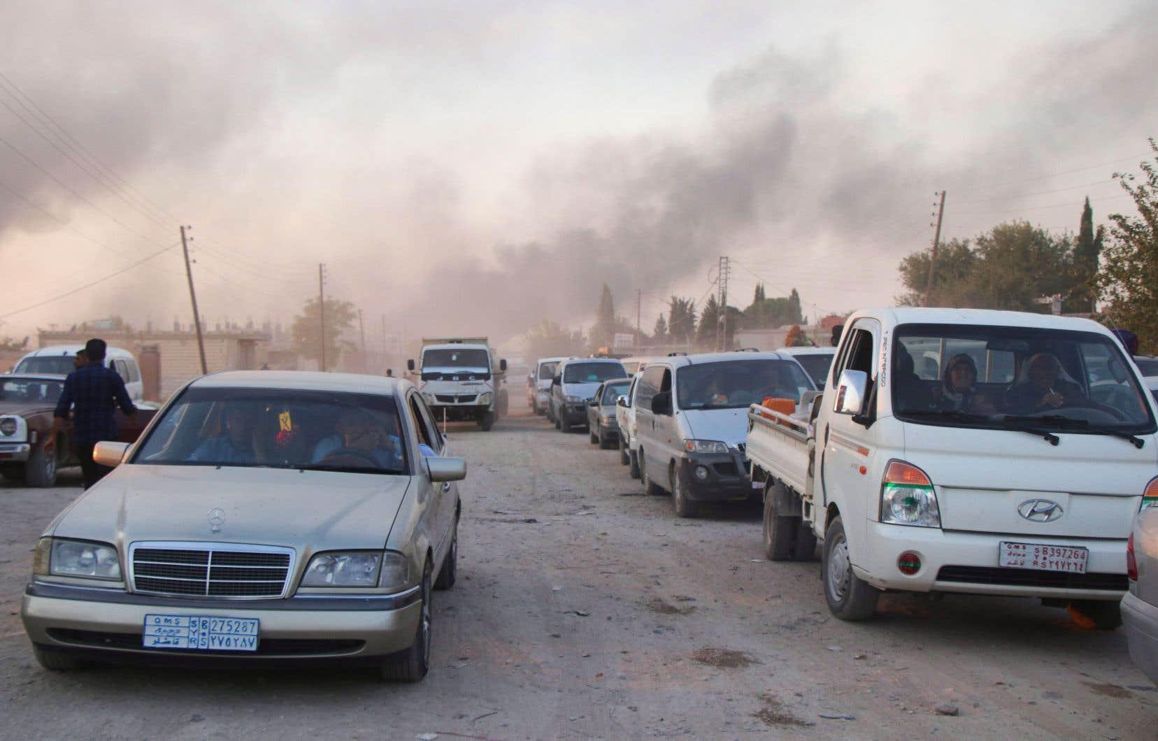 Le bombardement de Ras al-Aïn par l'armée turque a provoqué la fuite des civils kurdes, mercredi.
