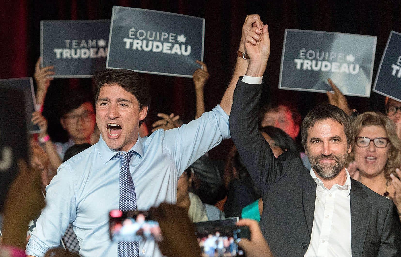 Justin Trudeau en compagnie de Steven Guilbault, lors d'une activité partisane à Montréal en juillet dernier