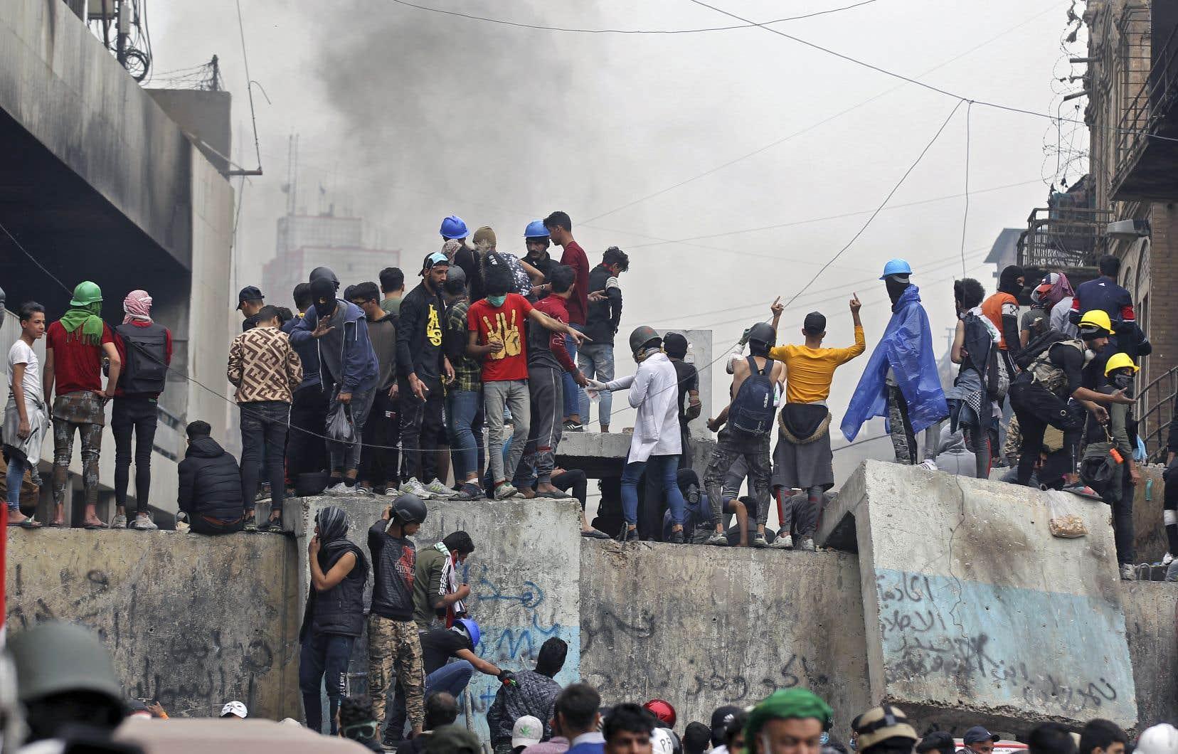 Des affrontements entre les contestataires et les forces de l'ordre ont éclaté, jeudi, dans plusieurs villes du pays, notamment à Bagdad.
