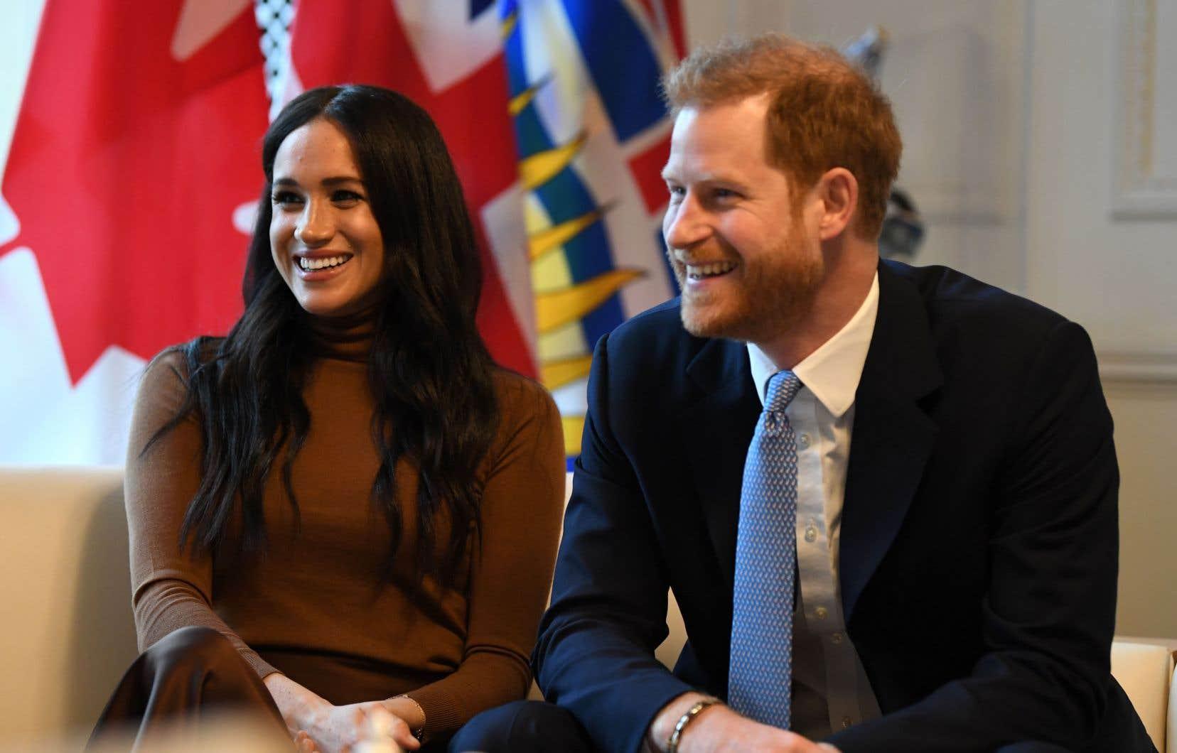 Meghan et Harry, photographiés mardi à London, en Ontario, au terme de leurs longues vacances au Canada