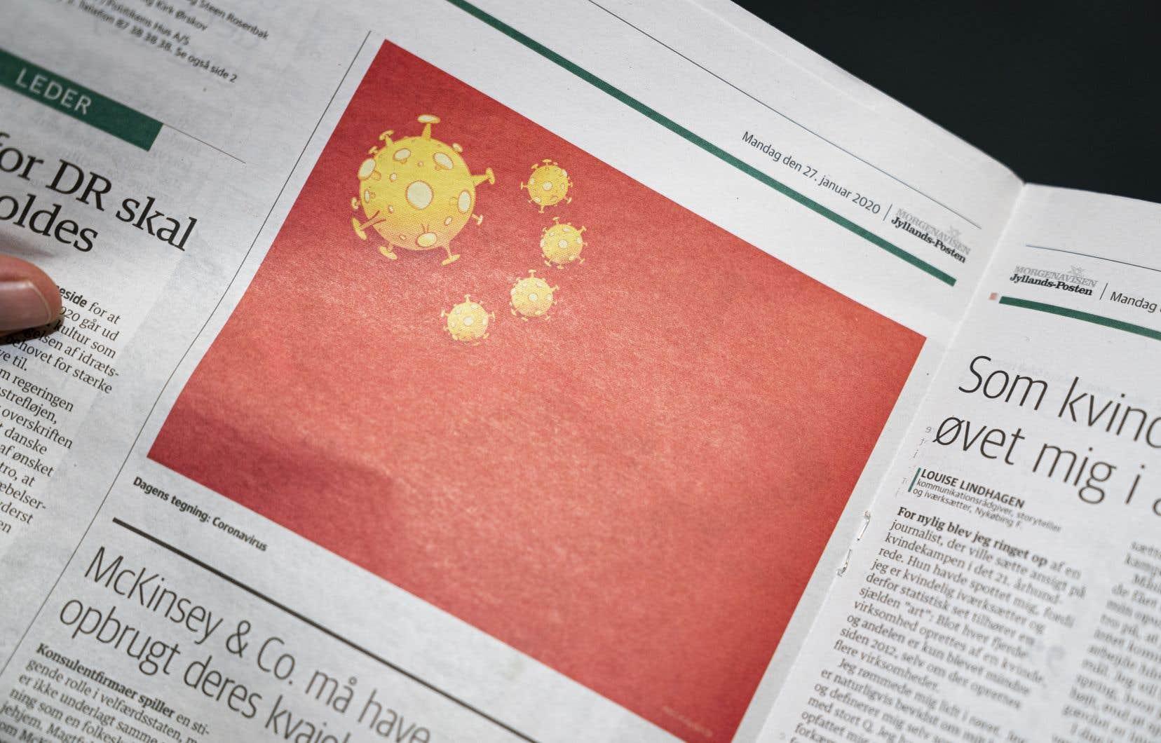 La caricature montre le drapeau chinois avec ce qui ressemble à des virus au lieu des étoiles habituelles.