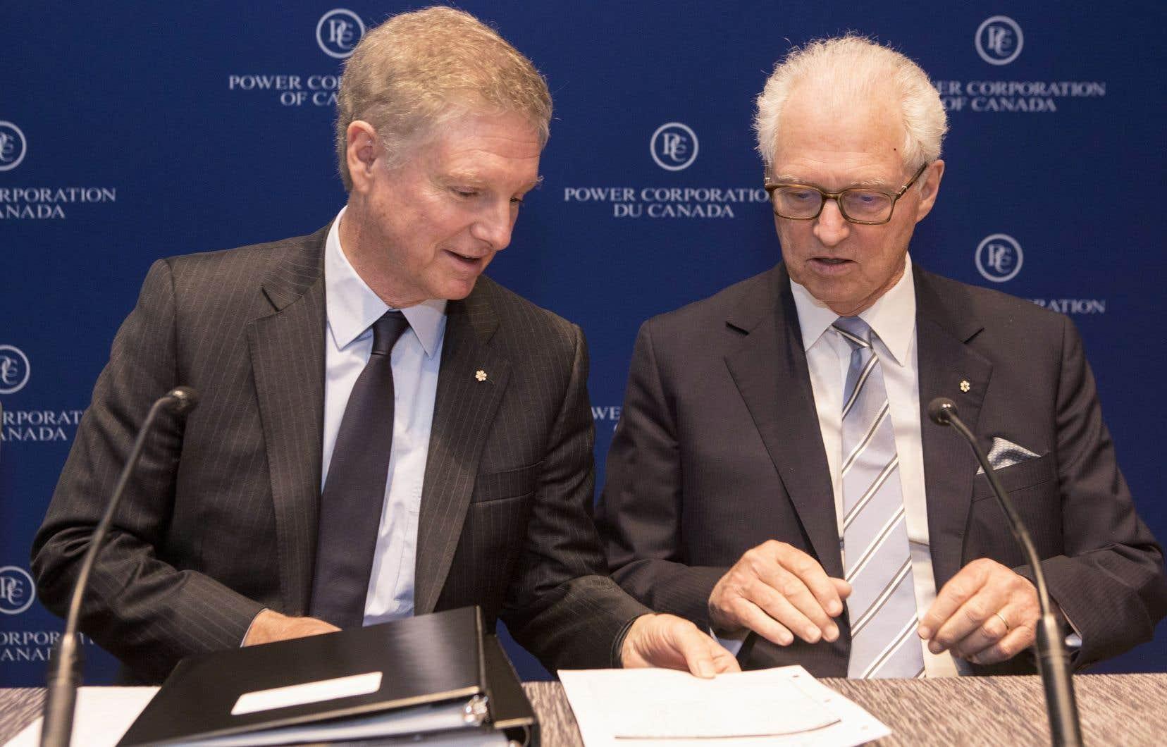 Paul Desmarais fils (à gauche) et André Desmarais (à droite) quitteront leurs fonctions, mais demeureront respectivement président et vice-président du conseil d'administration.