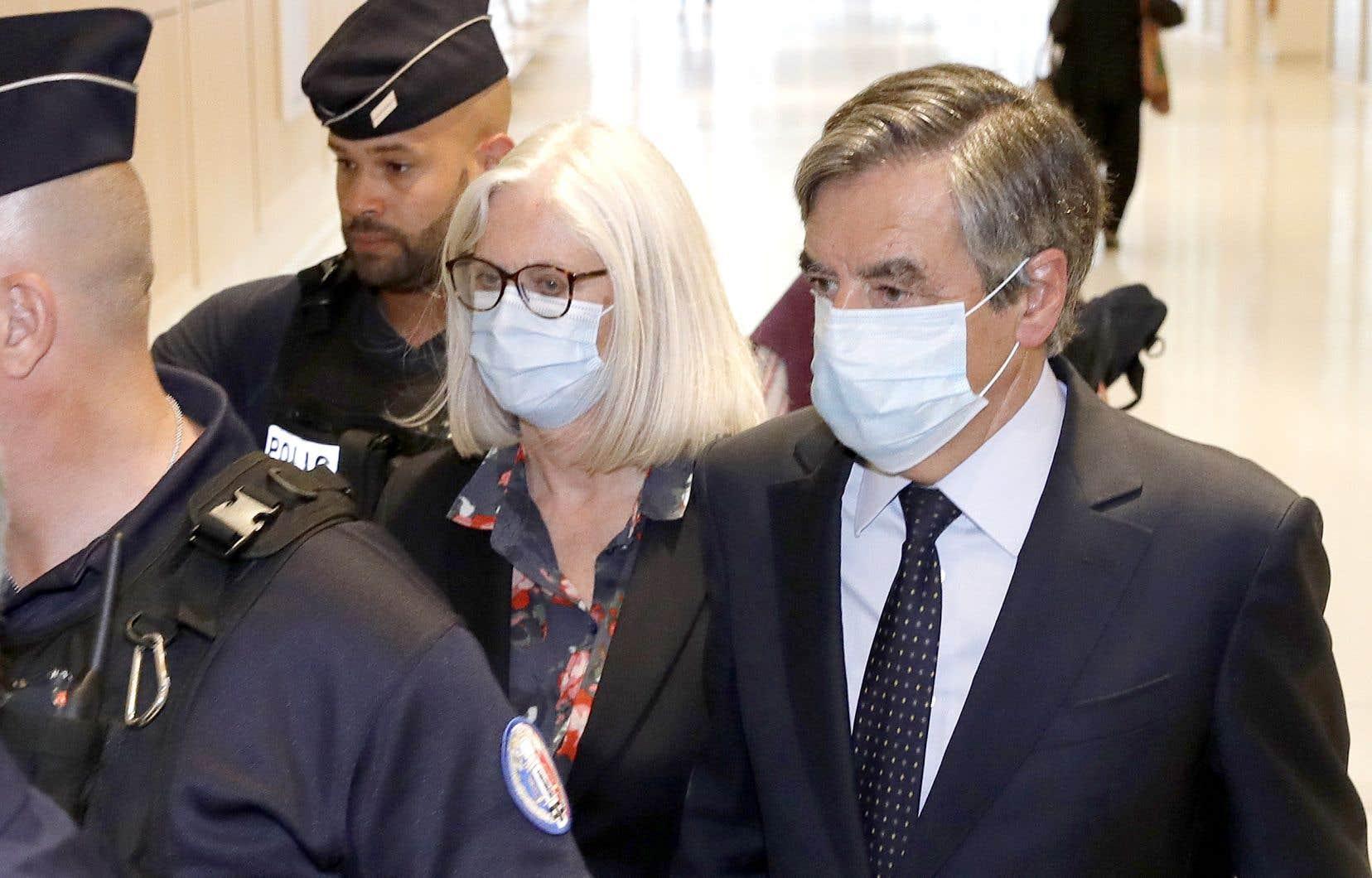 François Fillon et son épouse, Penelope, au tribunal de Paris, lundi 29 juin
