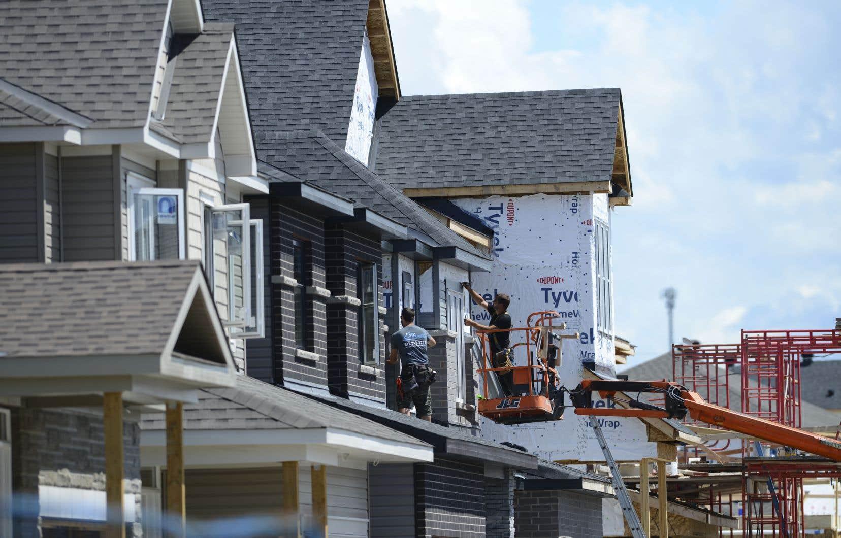 Une maison en construction dans un nouveau développement à proximité d'Ottawa