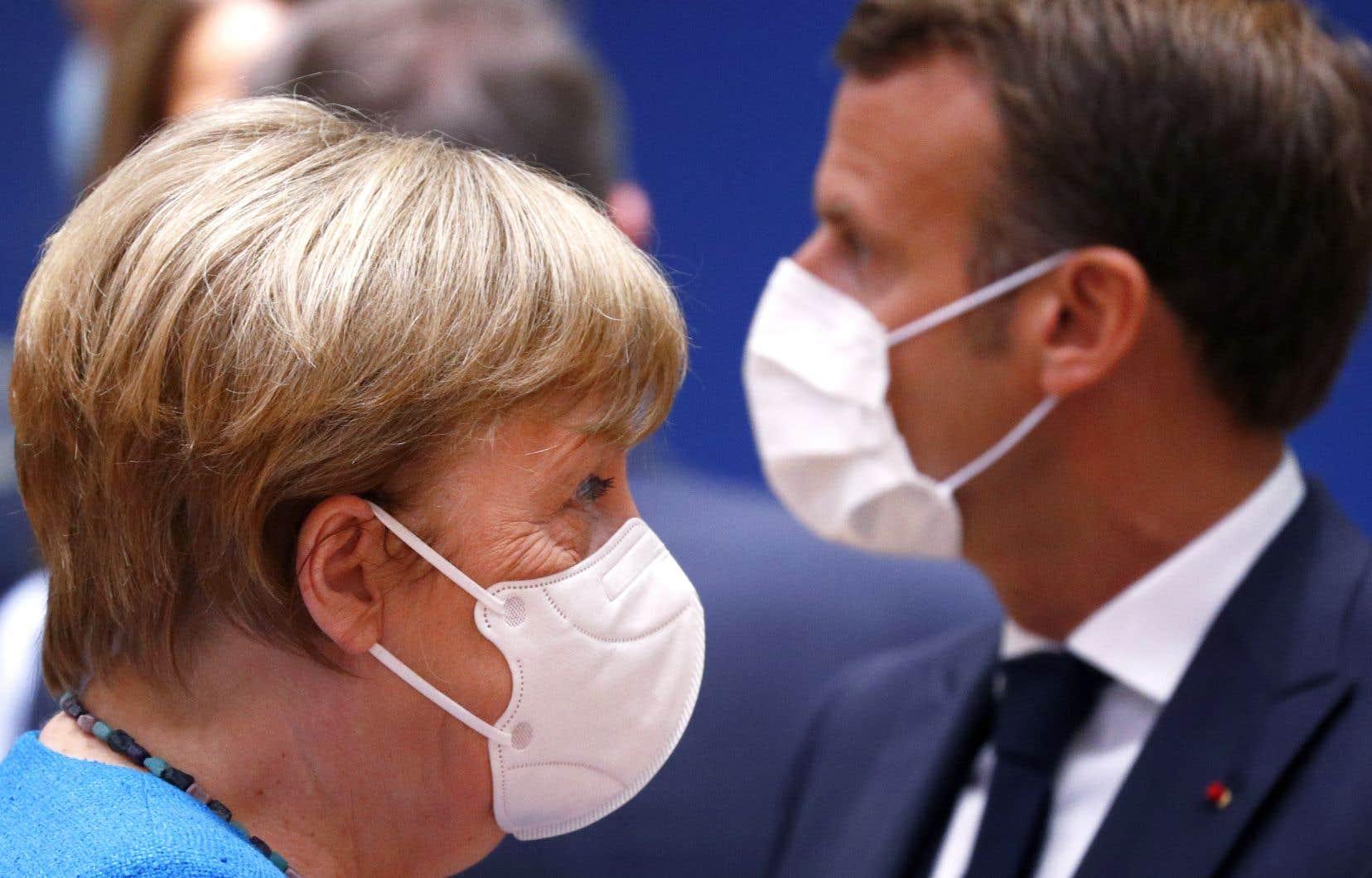 La chancelière allemande, Angela Merkel (à gauche), a prévenu dimanche qu'il était possible que les négociations n'aboutissent à aucun résultat.