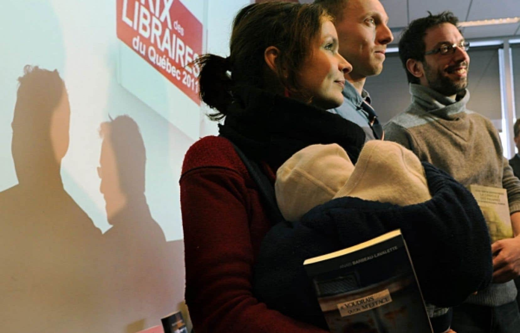 Les finalistes des 18es Prix des libraires du Québec ont été dévoilés hier à la Grande Bibliothèque. Ci-dessus, trois des auteurs toujours en lice: la réalisatrice Anaïs Barbeau-Lavalette (ici avec son petit Manoé dans les bras), Nicolas Langelier et Jean-Simon DesRochers. Le gagnant sera dévoilé le 9 mai.<br />
