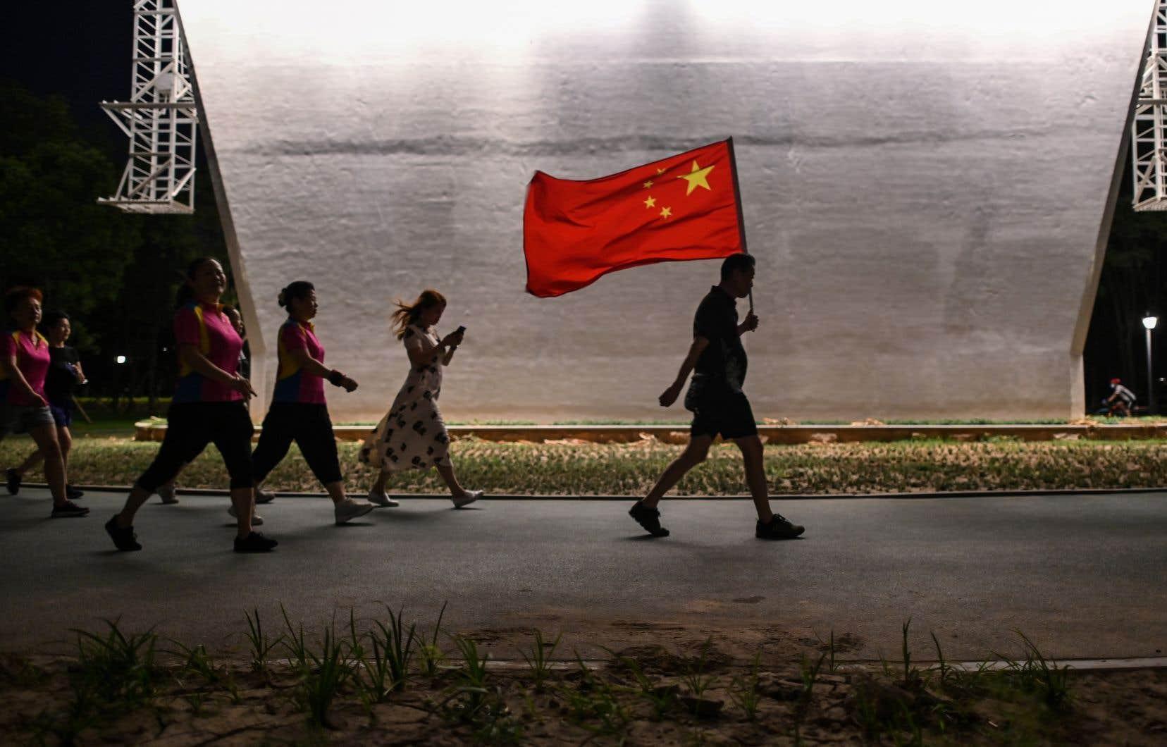 La Chine présente la ville de Wuhan comme preuve de sa capacité à contrôler l'épidémie.