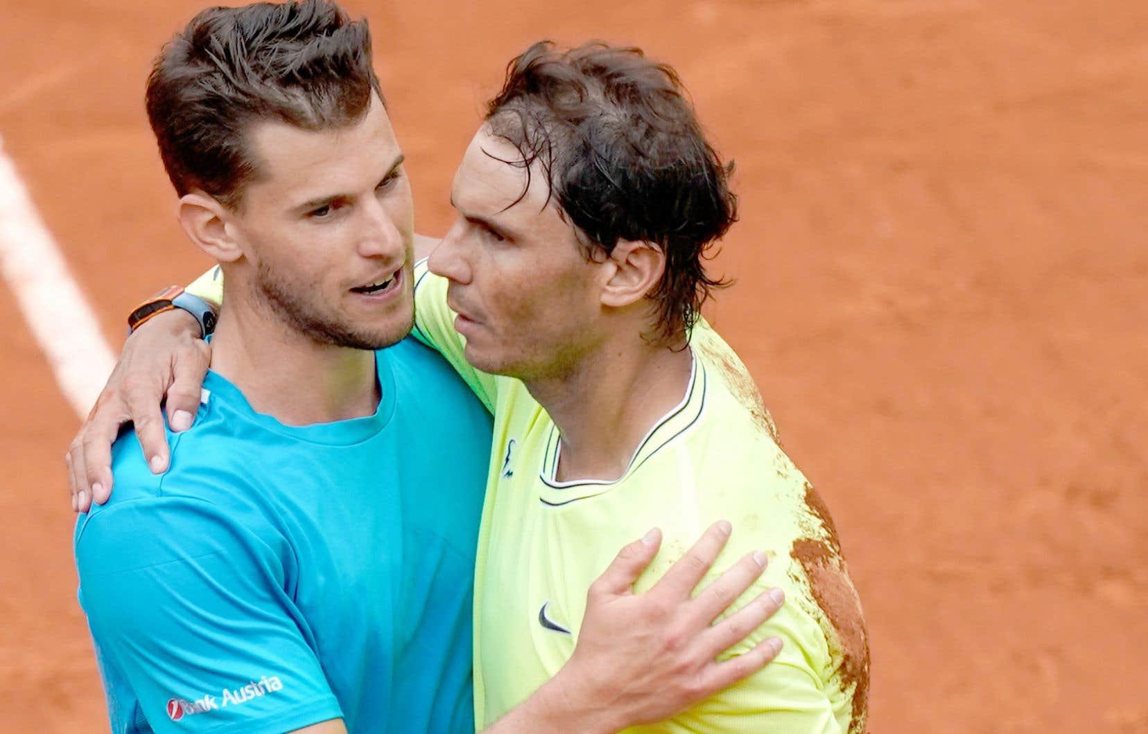 Le tournoi parisien ne se conclura pas pour la troisième année d'affilée par une finale entre l'Espagnol Rafael Nadal (à droite) et l'Autrichien Dominic Thiem, qui se rencontreront, en cas de victoires, en demi-finale.
