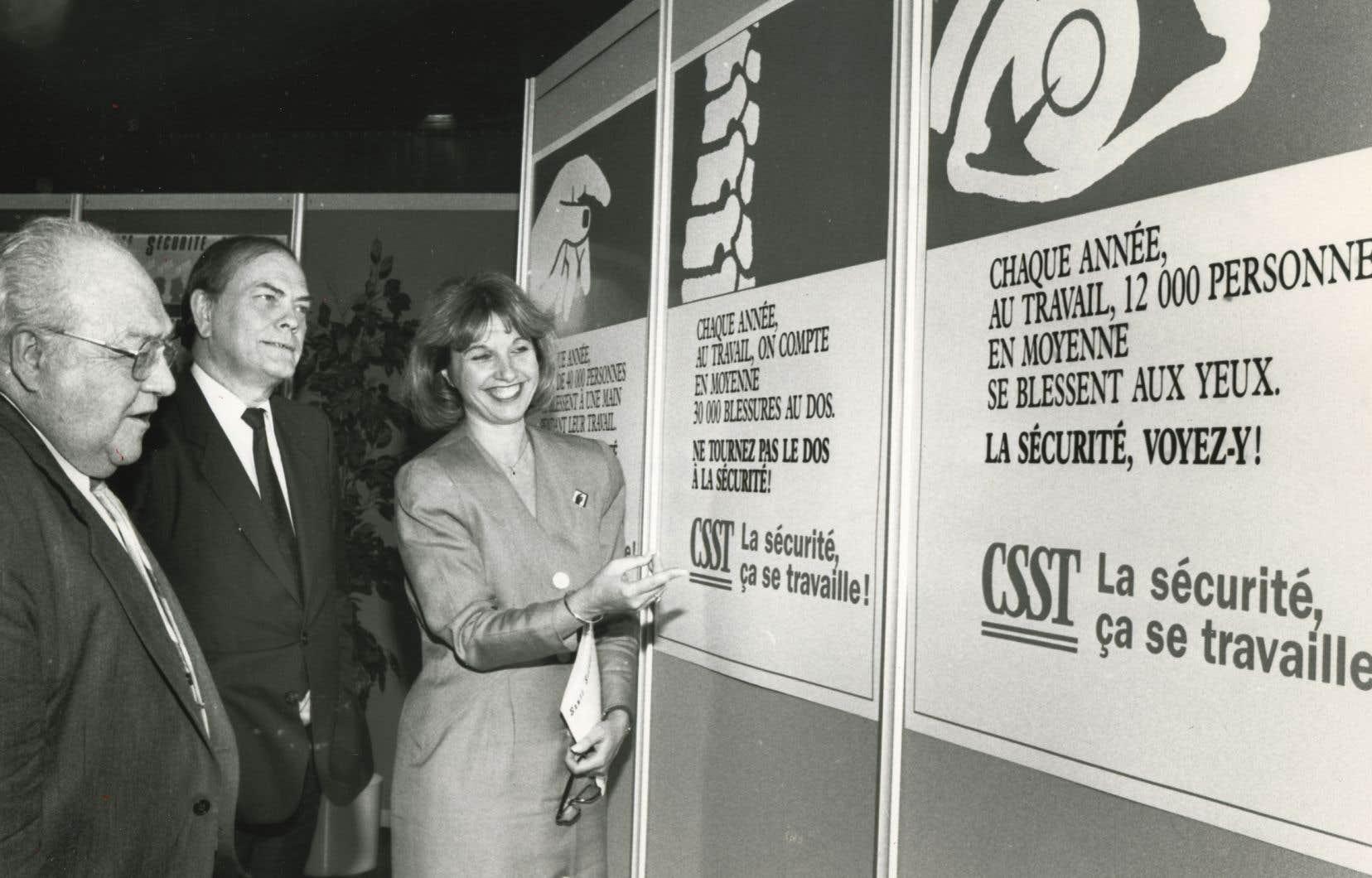 Louis Laberge, Ghislain Dufour et Monique Jérôme-Forget, en octobre 1987. À l'époque, ils étaient respectivement président de la FTQ, président du CPQ et présidente de la CSST.