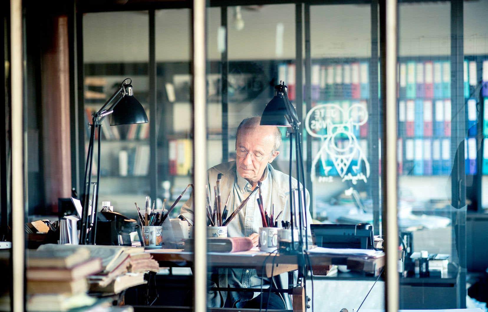 On a rencontré le bédéiste Philippe Geluck dans son atelier bruxellois par un après-midi de «drache» typiquement belge.