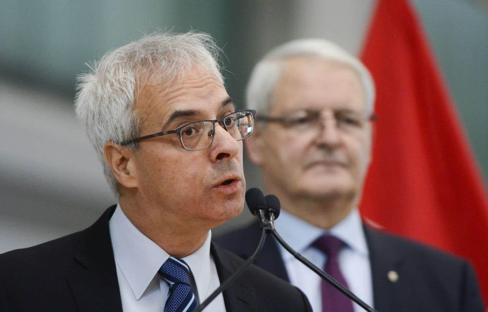 Le président de l'Office des transports du Canada (OTC), Scott Streiner, et le ministre fédéral des Transports, Marc Garneau