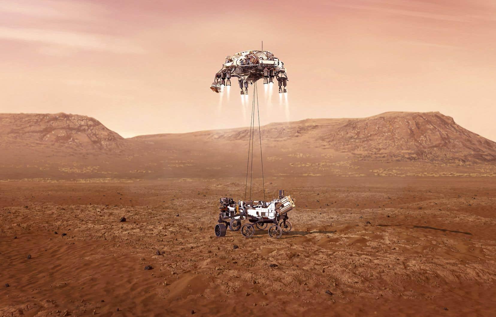 Comme le montre cette image de synthèse, huit rétrofusées ont fini de ralentir le vaisseau avant que l'astromobile ne déploie ses six roues, suspendue le long de câbles jusqu'au contact avec le sol.