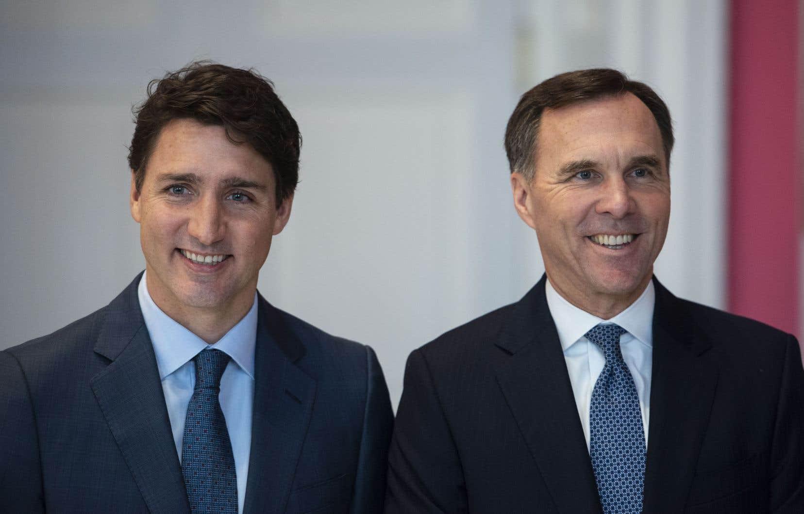Le premier ministre fédéral, Justin Trudeau, et son ex-ministre des Finances, Bill Morneau