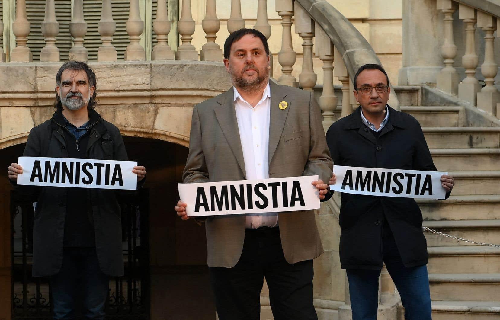 De gauche à droite, les leaders séparatistes catalans Jordi Cuixart, Oriol Junqueras et Josep Rull, en février 2021