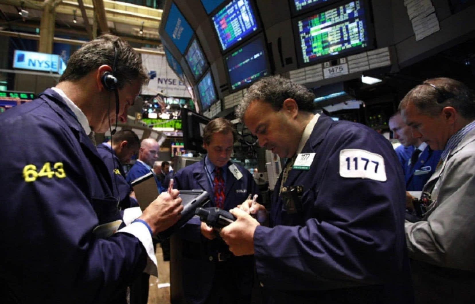 Des courtiers à l'œuvre à la Bourse de New York.<br />