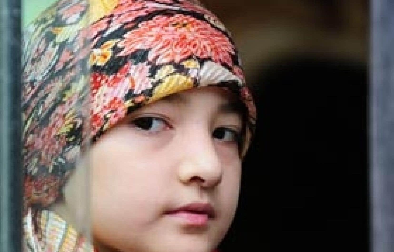 Une jeune Ouïgour de la ville d'Urumqi, largement touchée par les violences ethniques au cours des dernières semaines.
