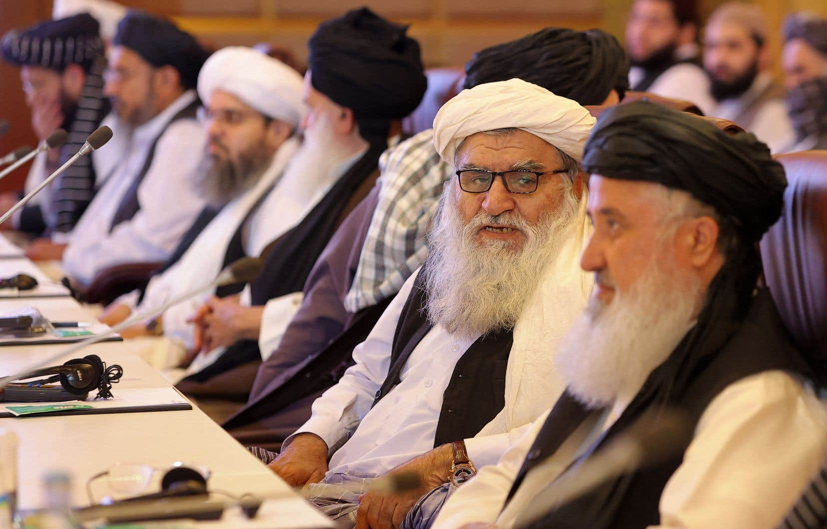 Des membres de la délégation des talibans lors de pourparlers avec le gouvernement afghan, à Doha le 18 juillet dernier.