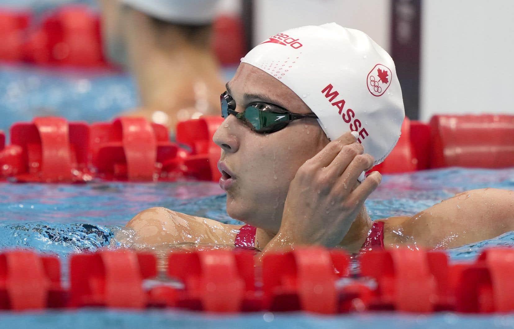 La nageuse canadienne Kylie Masse a remporté l'argent avec un temps de 57,72 secondes.