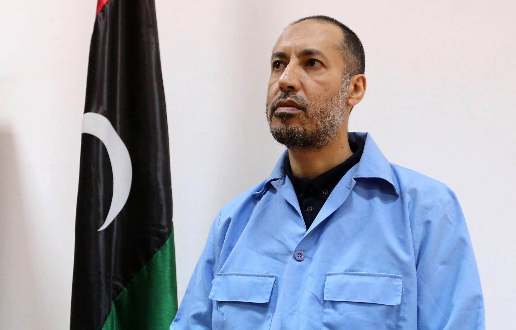 Sur cette photo prise le 13 mars 2016, Saadi Kadhafi, le fils du dictateur libyen assassiné Mouammar Kadhafi, attend son procès dans un palais de justice de la capitale libyenne Tripoli.