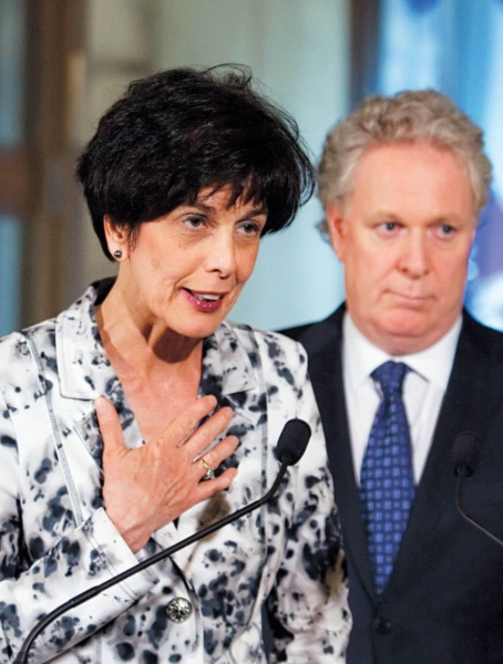 <div> La ministre de l'Éducation, Michelle Courchesne et le premier ministre, Jean Charest.</div>