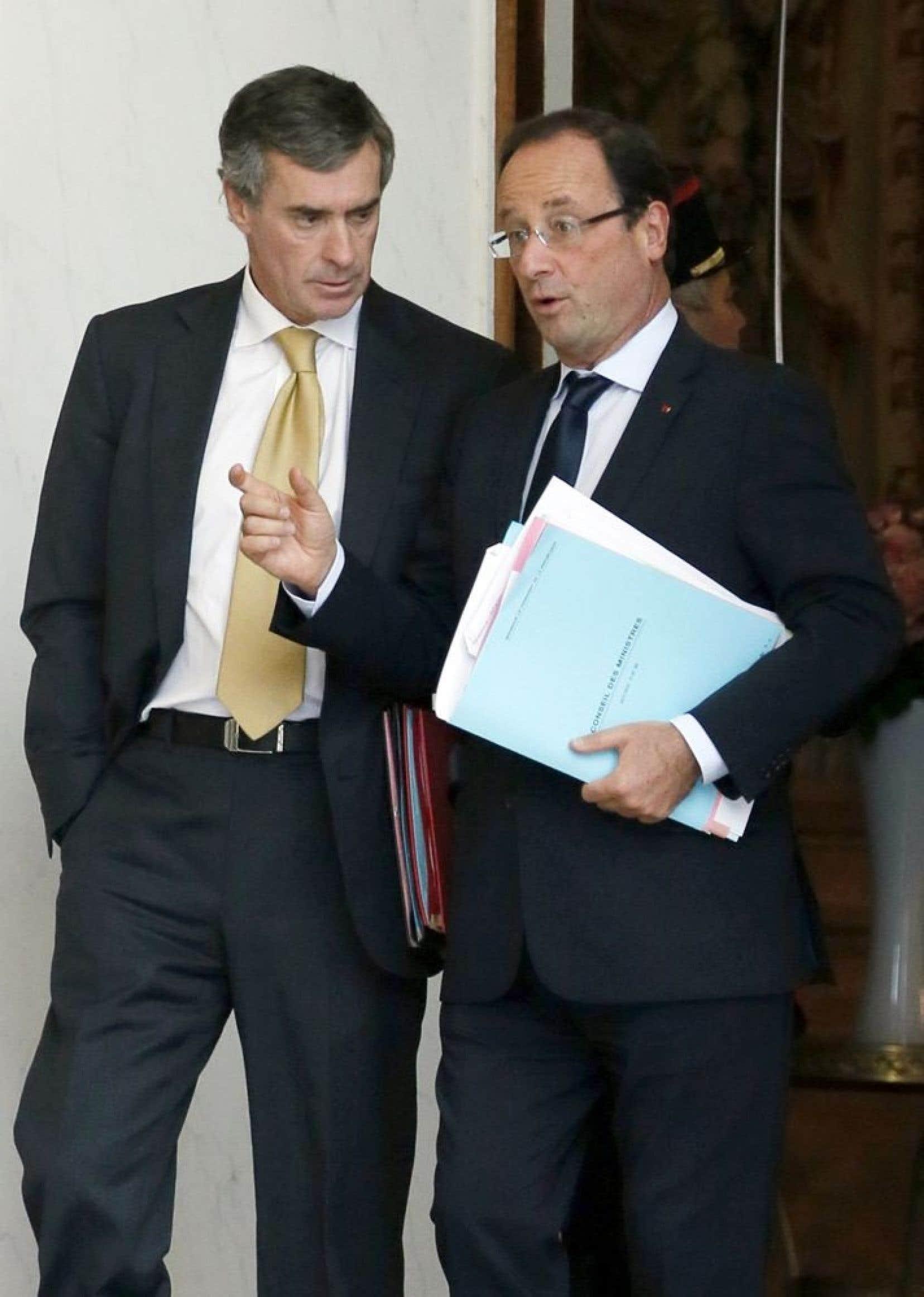Le pr&eacute;sident fran&ccedil;ais Fran&ccedil;ois Hollande (&agrave; droite) et J&eacute;r&ocirc;me Cahuzac.<br />